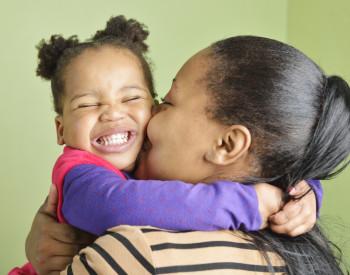 African toddler hugging her mom
